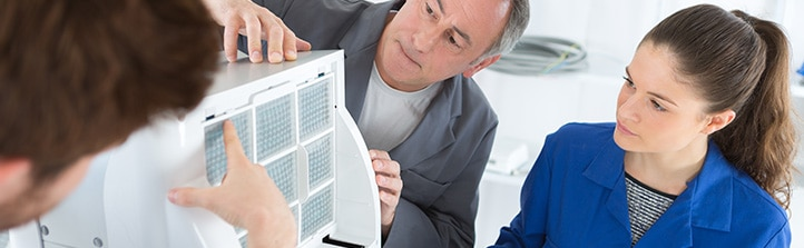 people checking air conditioning unit